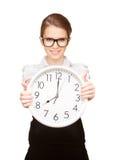 Mujer que sostiene el reloj grande Fotografía de archivo libre de regalías