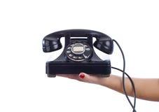 Mujer que sostiene el teléfono del vintage Imagenes de archivo