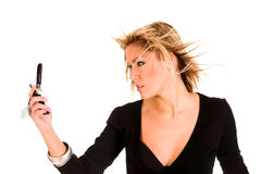 Mujer que sostiene el teléfono móvil Fotografía de archivo