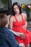 Mujer que sostiene la panza embarazada Imágenes de archivo libres de regalías