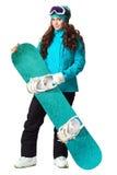Mujer que sostiene la snowboard en estudio Fotografía de archivo