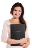 Mujer que sostiene un fichero de aplicación Fotografía de archivo