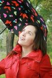 Mujer que sostiene un paraguas Fotografía de archivo