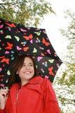 Mujer que sostiene un paraguas Fotos de archivo