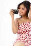 Mujer que sostiene una cámara Imagenes de archivo