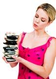 Mujer que sostiene una pila de teléfonos móviles foto de archivo libre de regalías
