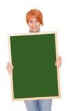 Mujer que sostiene una pizarra Imagen de archivo libre de regalías