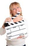Mujer que sostiene una pizarra de la película Foto de archivo