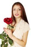 Mujer que sostiene una rosa Imágenes de archivo libres de regalías