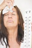 Mujer que sufre de calor y de sudor Foto de archivo libre de regalías