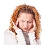 Mujer que sufre de dolor de cabeza Imagen de archivo libre de regalías
