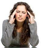 Mujer que tiene dolor de cabeza Foto de archivo libre de regalías