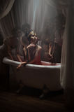 Mujer que tiene un baño de sangre Imagen de archivo libre de regalías