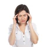 Mujer que tiene un dolor de cabeza Foto de archivo libre de regalías