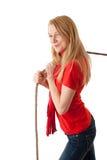 Mujer que tira de la cuerda gris Fotografía de archivo libre de regalías