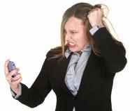 Mujer que tira de su pelo Fotos de archivo