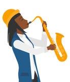 Mujer que toca el saxofón Imagenes de archivo