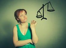 Mujer que toma la decisión Fotografía de archivo