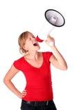 Mujer que usa el megáfono Imagen de archivo libre de regalías