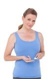 Mujer que usa el moniter de la glucosa en sangre de la diabetes Fotografía de archivo libre de regalías
