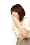 Mujer que vomita Imagen de archivo