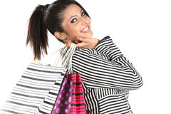 Mujer que vuelve con los bolsos de compras Imagen de archivo