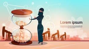 Mujer árabe con el aceite Rig Crane Platform Wealth Concept de Pumpjack del dinero del reloj de la arena Imágenes de archivo libres de regalías