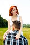 Mujer Redheaded con el hombre Imagen de archivo libre de regalías