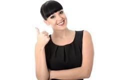 Mujer relajada alegre positiva feliz con los pulgares para arriba Imagen de archivo libre de regalías