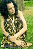 Mujer rizada pensativa Imagen de archivo libre de regalías