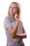 Mujer rubia con el pensamiento de la pista de nota. Aislado. #1 Fotos de archivo