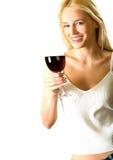 Mujer rubia con el rojo-vino Imágenes de archivo libres de regalías