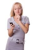 Mujer rubia con el teléfono celular aislado. #1 Imagen de archivo