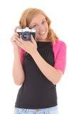 Mujer rubia con la cámara retra Foto de archivo libre de regalías