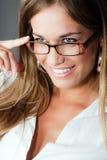 Mujer rubia con las lentes Imagen de archivo libre de regalías