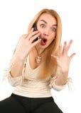 Mujer rubia emocional con el teléfono Foto de archivo libre de regalías