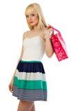 Mujer rubia en alineada con un bolso Imagen de archivo libre de regalías