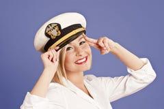 Mujer rubia en casquillo de los oficiales Imagen de archivo libre de regalías