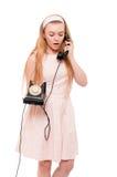 Mujer rubia en el vestido rosado aislado Fotografía de archivo libre de regalías