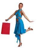 Mujer feliz con el bolso de compras Foto de archivo libre de regalías