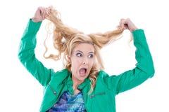 Mujer rubia insana Foto de archivo