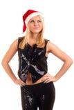 Mujer rubia joven atractiva en el sombrero de Santa Imagen de archivo libre de regalías