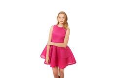 Mujer rubia joven con la falda rosada Imagenes de archivo