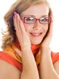 Mujer rubia joven con los vidrios a disposición Imagenes de archivo
