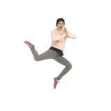 Mujer rubia joven en el salto del estudio Fotografía de archivo libre de regalías