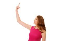 Mujer rubia joven que destaca Imagen de archivo