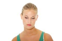 Mujer rubia joven triste. Fotografía de archivo