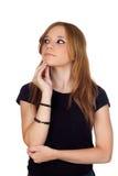 Mujer rubia pensativa con la camisa negra Foto de archivo