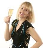Mujer rubia que celebra con un vidrio de champán Imágenes de archivo libres de regalías