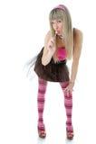 Mujer rubia que lame el caramelo Foto de archivo libre de regalías